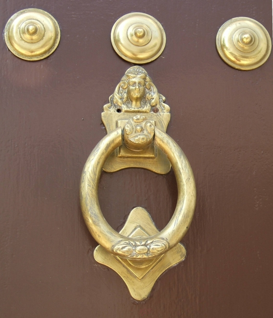 Door knocker from door with ornate inner door